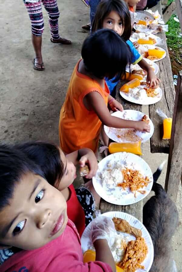 "alt=""Kids are enjoying fruit juice, rice, and spaghetti"""