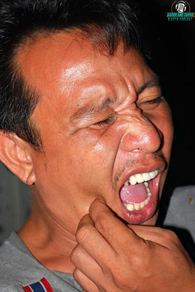 "alt=""A Filipino man suffering from a toothache"""