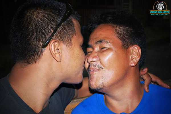 "alt=""Two drank men kissing one another"""