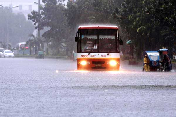 "alt=""Resilient in Filipino bus crossing the flood"""