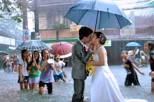 "alt=""Resilient in Filipino marriage wedding in flood"""
