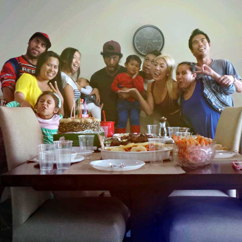 "alt=""Happy Filipino family celebrating the new year"""