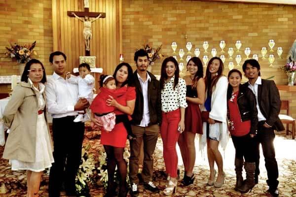 """alt=""""A Filipino family attending the Misa de Gallo"""""""