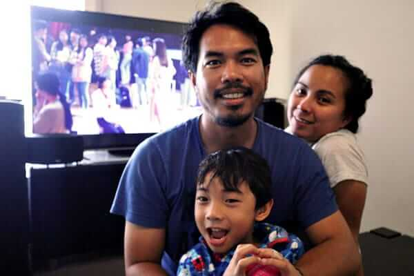 "alt=""A happy Filipino family poses a picture"""