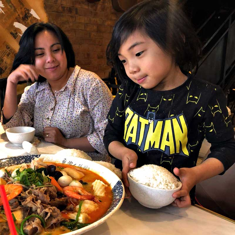"""alt=""""Mother and son eating their favourite Sinigang na Hipon"""""""