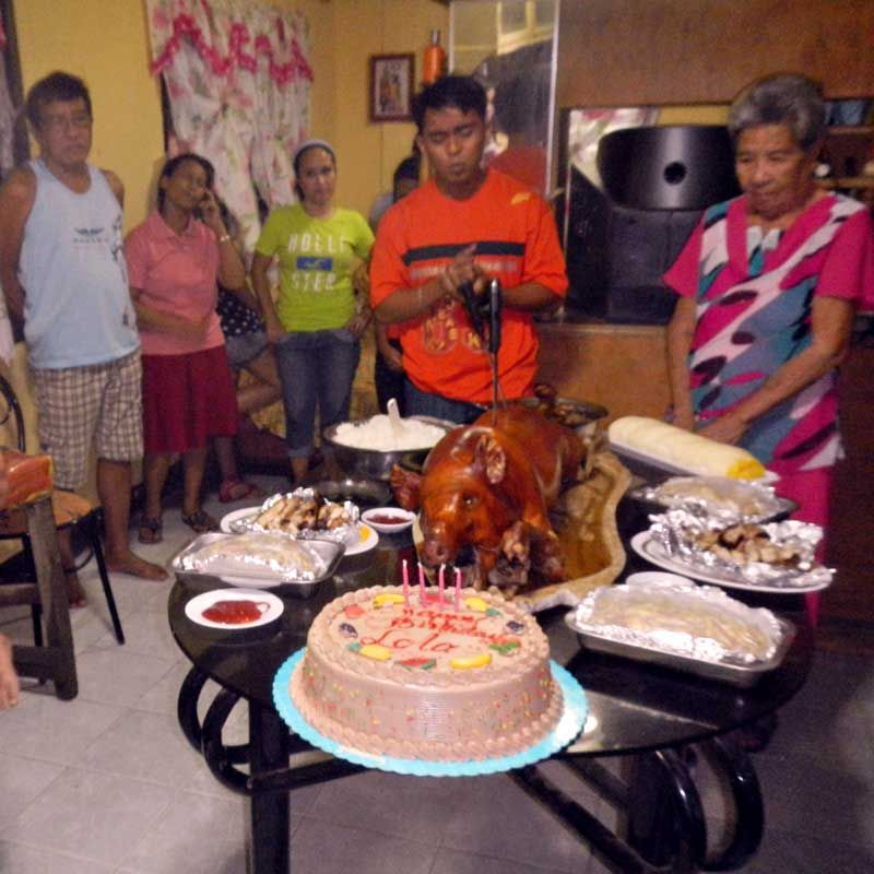 """alt=""""A happy family gather around the Pinoy Handaan"""""""